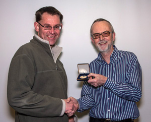 "John Bogle from Havant CC being presented with a PAGB Gold Medal for his PDI ""Shared Roost"""
