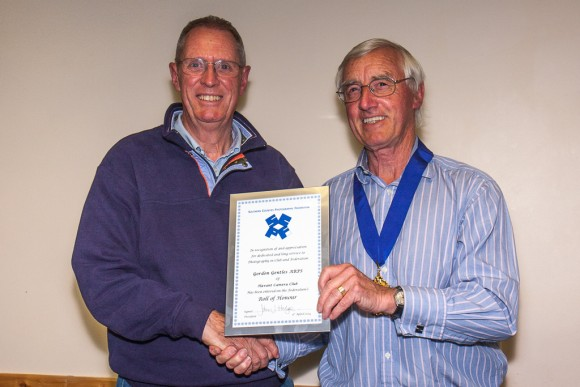 Gordon Gentles receives his roll of honour from John Hodge.