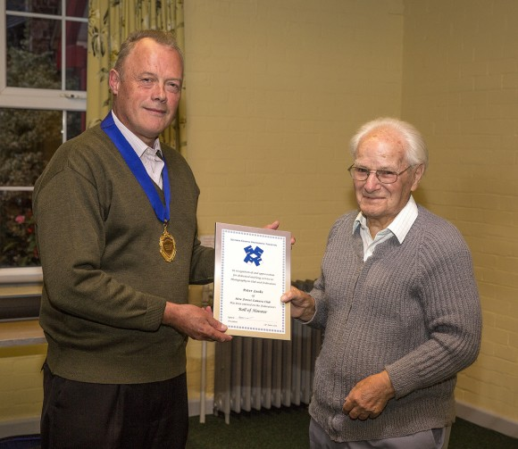 Tony Oliver presents Peter Locke with his Roll of Honour